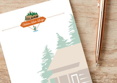 Hidden Lake Lodge Logo on Notepad